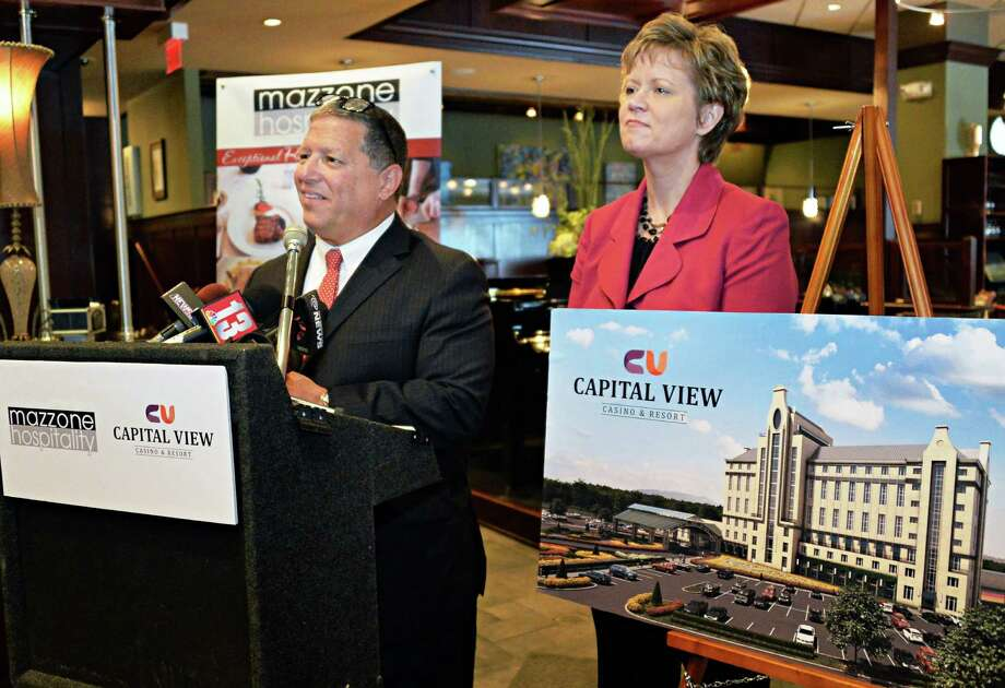 Angelo Mazzone,left, owner of Mazzone Hospitality and Rita Cox, SVP of marketing and external affairs at Saratoga Casino and Raceway, announce a restaurant alliance with Capital View Casino & Resort during a news conference at Angelo's 677 Prime restaurant Wednesday, June 18, 2014, in Albany, N.Y.  (John Carl D'Annibale / Times Union) Photo: John Carl D'Annibale / 00027409A