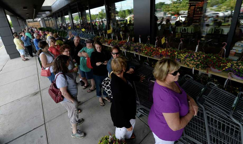 A large line of patrons builds outside of the new Whole Foods Market Colonie store Tuesday morning, June 18, 2014, on opening day at Colonie Center in Colonie, N.Y.  (Skip Dickstein / Times Union) Photo: SKIP DICKSTEIN / 00027382A