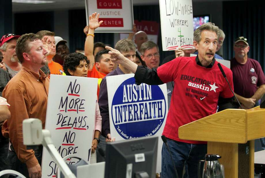 Ken Zarifis, president of Education Austin, a teacher and school employees union for AISD, speaks to AISD trustees at a board meeting on Monday, June 16, 2014, in support of better wages, in Austin, Texas. (AP Photo/Austin American-Statesman, Laura Skelding) Photo: Laura Skelding, MBO / Austin American-Statesman