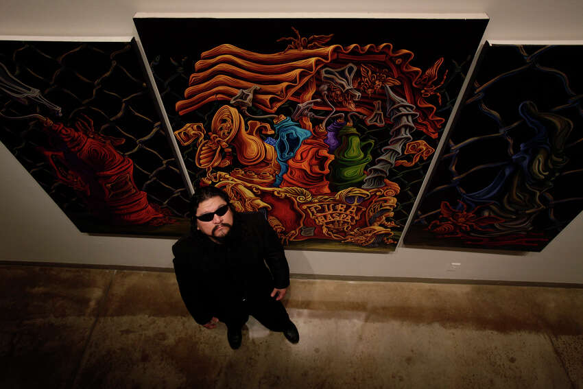 Read more about these artists on ExpressNews.com. Local artist Alex Rubio by his artwork,