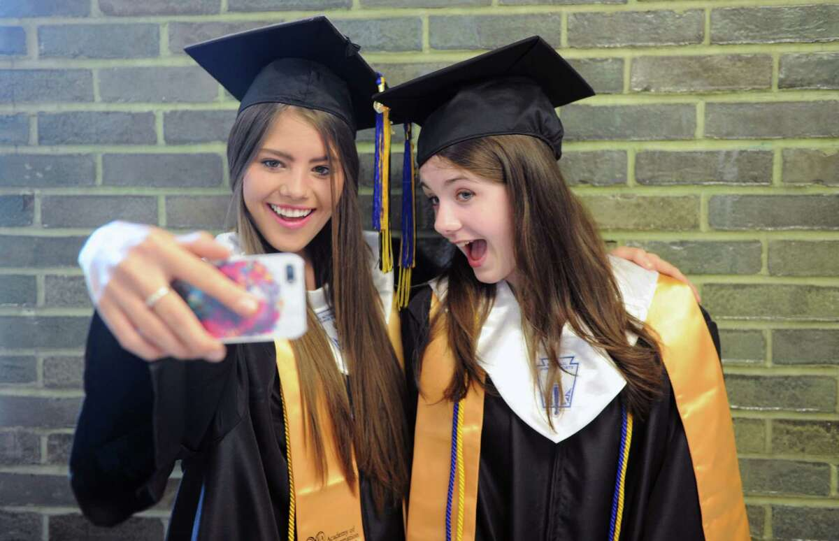 Roxy Kachmarska and Hanna Kahlert at the Academy of Information Technology & Engineering graduation on Wednesday, June 18, 2014 in Stamford, Conn.