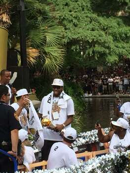 NBA Finals MVP Kawhi Leonard smiles as his barges floats by during the Spurs victory parade on the San Antonio River on Wednesday, June 18, 2014. Photo: Mitchell Ferman / San Antonio Express-News