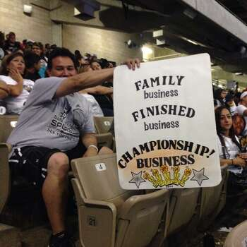 A Spurs fan holds up a sign at the Alamodome prior to the Spurs celebration on Wednesday, June 18, 2014. Photo: Rebecca Salinas/San Antonio Express-News