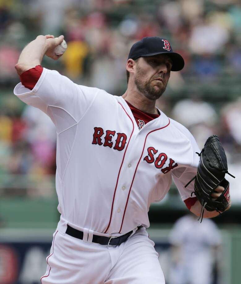 Boston Red Sox starting pitcher John Lackey during the first inning of a baseball game at Fenway Park in Boston, Wednesday, June 18, 2014. (AP Photo/Charles Krupa) Photo: Charles Krupa, Associated Press
