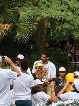 Tim Duncan holds the Larry O'Brien trophy during the Spurs victory parade on the San Antonio River on Wednesday, June 18, 2014. Photo: Mitchell Ferman / San Antonio Express-News