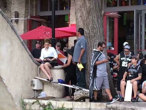 Spurs fans wait for the start of the team's victory parade on the San Antonio River on Wednesday, June 18, 2014. Photo: Rebecca Fiedler/San Antonio Express-News