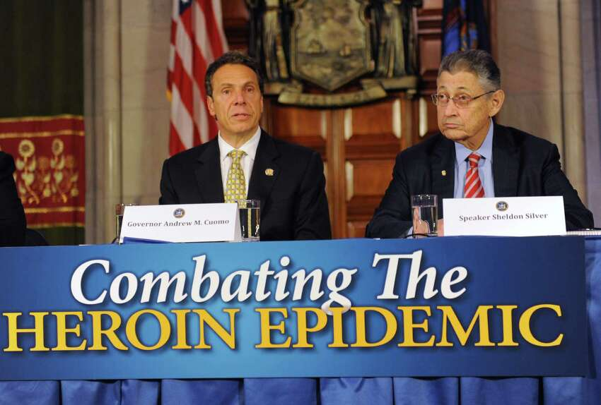 Governor Andrew Cuomo speaks about a heroin bill as top priority of end of session during a press conference at the Capitol Wednesday, June 18, 2014 in Albany, N.Y. Speaker Sheldon Silver sits at right. (Lori Van Buren / Times Union)