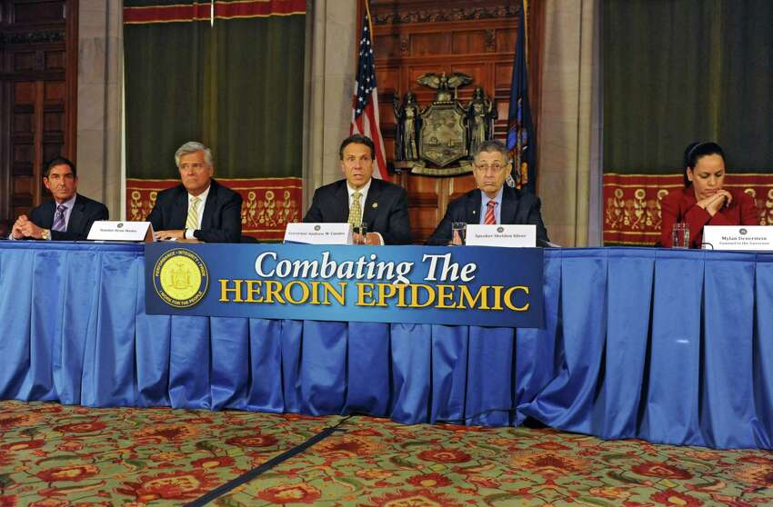 Governor Andrew Cuomo, center, speaks about a heroin bill as being a top priority for the end of session Wednesday, June 18, 2014, during a press conference at the Capitol in Albany, N.Y. Sitting with him from left are: Senate co-leader Jeff Klein, Republican leader Dean Skelos, Speaker Sheldon Silver and Mylan Denerstein, Counsel to the Governor. (Lori Van Buren / Times Union)