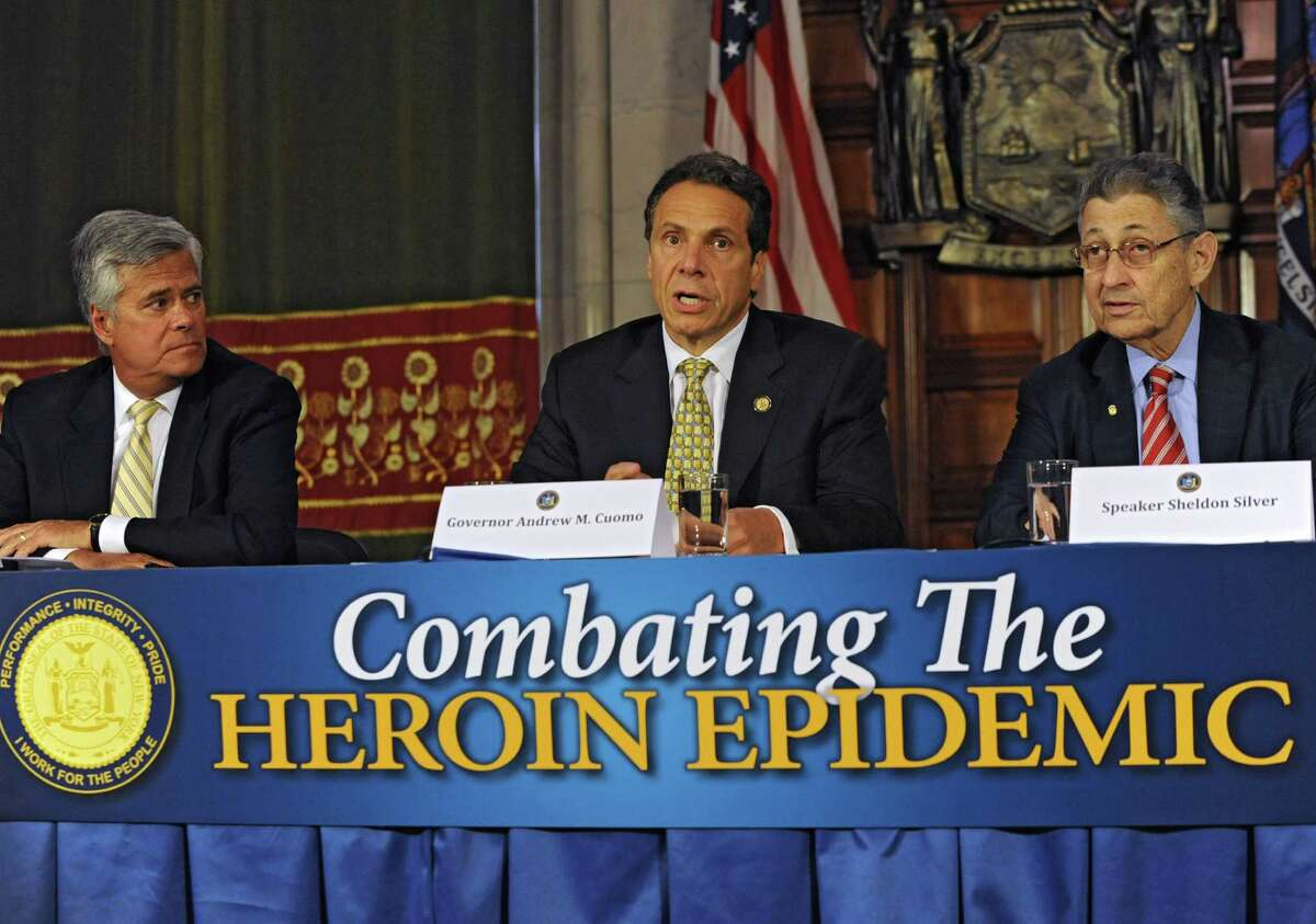 Governor Andrew Cuomo, center, speaks about a heroin bill as being a top priority for the end of session Wednesday, June 18, 2014, during a press conference at the Capitol in Albany, N.Y. Sitting with him are Senate Republican leader Dean Skelos, left, and Assembly Speaker Sheldon Silver. (Lori Van Buren / Times Union)