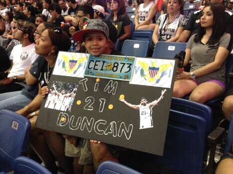 A young Spurs fan holds up a sign dedicated to Tim Duncan at the Spurs celebration at the Alamodome on Wednesday, June 18, 2014. Photo: Rebecca Salinas/San Antonio Express-News