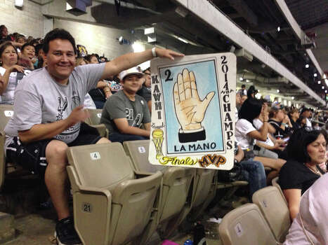 A Spurs fan holds up a loteria-esque poster for Kawhi at the Spurs celebration at the Alamodome on Wednesday, June 18, 2014. Photo: Rebecca Salinas/San Antonio Express-News