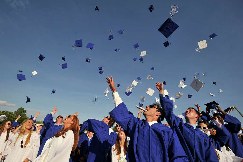 The class of 2014 throw their mortarboards into the air following the Darien High School graduation ceremony at Darien High School in Darien, Conn., on Wednesday, June 18, 2014. Photo: Jason Rearick / Stamford Advocate