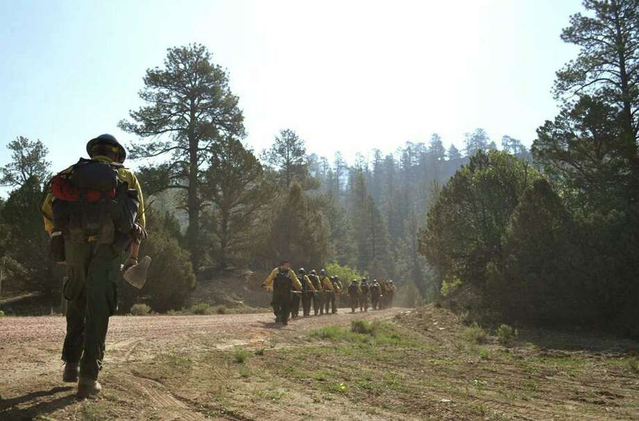Firefighters make their way to a blaze in the Chuska Mountains east of Navajo Pine, N.M. Flames forced residents of two Native American communities to leave their homes. Photo: Ravonelle Yazzie / Associated Press / Navajo Times