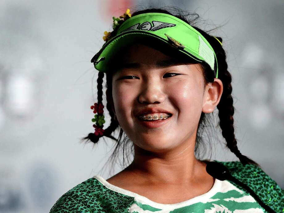 The week has been long on giggles from Lucy Li, the 11-year-old who is enjoying her time in the spotlight. Photo: Jeff Siner, MBR / Charlotte Observer