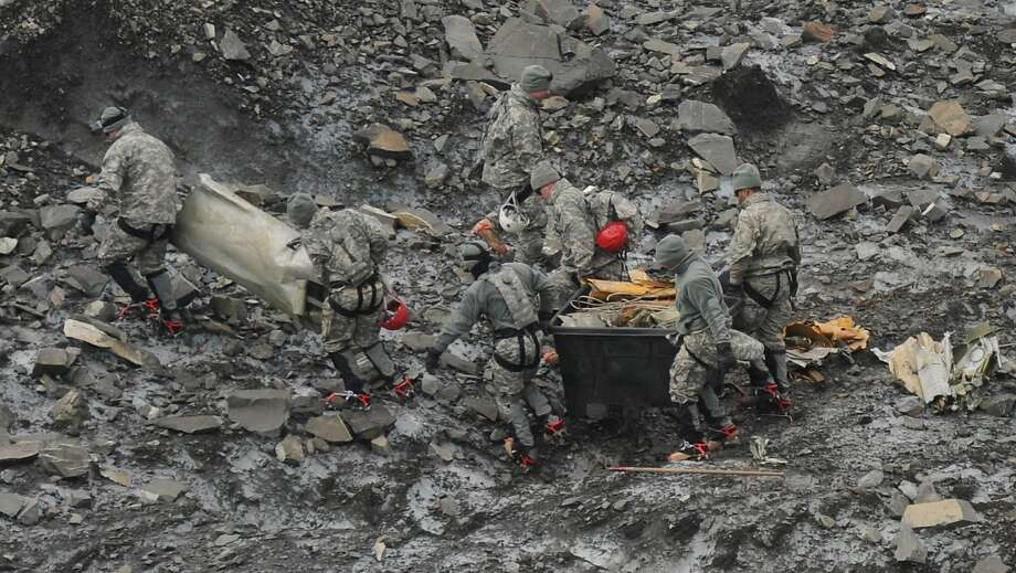 A 2012 file photo shows debris recovery on Colony Glacier in Alaska. The remains of 17 service members who died in a 1952 crash have been identified. Photo: Bill Roth, Associated Press