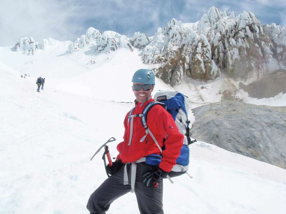 Tom Denham, is a career counselor, but his approach to ice climbing and careers is the same: You have to have goals. (Times Union archive photo) ORG XMIT: MER2014061816102392