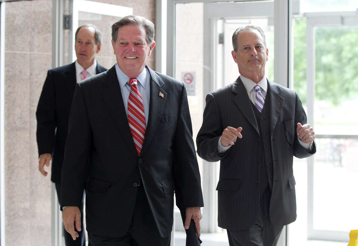 Tom DeLay, left, arrives with attorney Brian Wice on Wednesday at the Texas Court of Criminal Appeals in Austin, where prosecutors hope to get convictions for money laundering reinstated against DeLay.