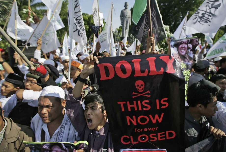 Muslim protesters rally insupport of the closing of Dolly red-light district in Surabaya, East Java, Indonesia, Wednesday. The government has shut down the red-light district amid protests by sex workers as well as dependents. Photo: Dita Alangkara / Associated Press / AP