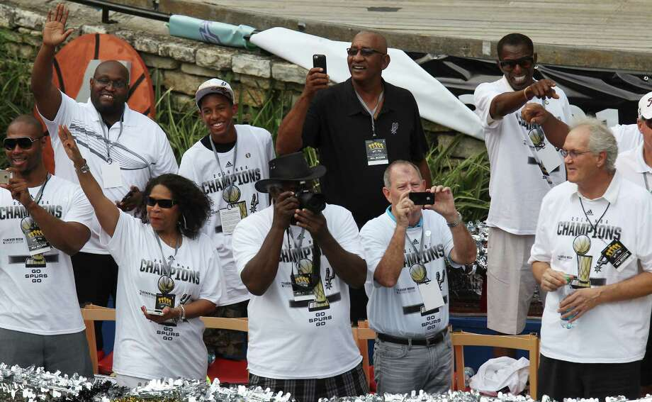 Former Spurs players including George Gervin (top center) take part in the river parade for the San Antonio Spurs after the team captured their fifth NBA championship on Wednesday, June 18, 2014. Photo: Kin Man Hui, San Antonio Express-News / ©2014 San Antonio Express-News
