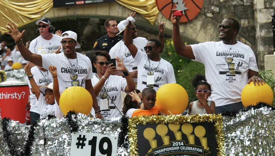 Former Spurs' Antonio Daniels (from left), Avery Johnson and Malik Rose take part in a river parade for the San Antonio Spurs after the team capture their fifth NBA championship on Wednesday, June 18, 2014. Photo: Kin Man Hui, San Antonio Express-News / ©2014 San Antonio Express-News