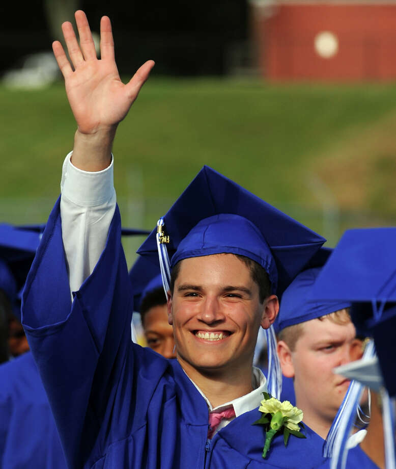 Graduate Joseph Taliercio waves to family during commencement for the Frank Scott Bunnell High School Class of 2014, in Stratford, Conn. June 18, 2014. Photo: Ned Gerard / Connecticut Post