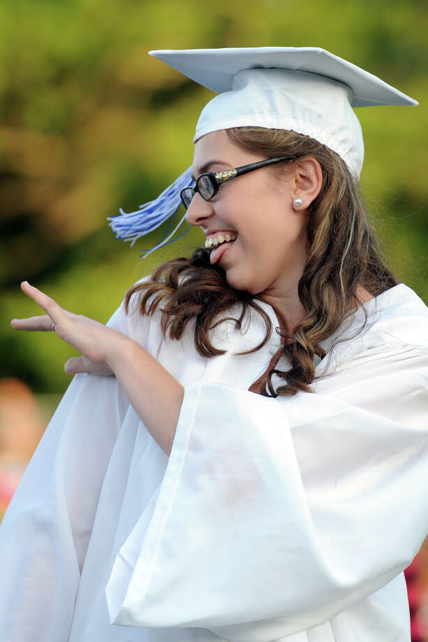 Graduate Hailey Meyernick celebrates during commencement for the Frank Scott Bunnell High School Class of 2014, in Stratford, Conn. June 18, 2014. Photo: Ned Gerard / Connecticut Post