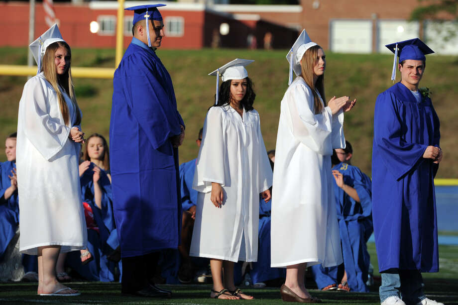 Graduates line up for their diplomas during commencement for the Frank Scott Bunnell High School Class of 2014, in Stratford, Conn. June 18, 2014. Photo: Ned Gerard / Connecticut Post