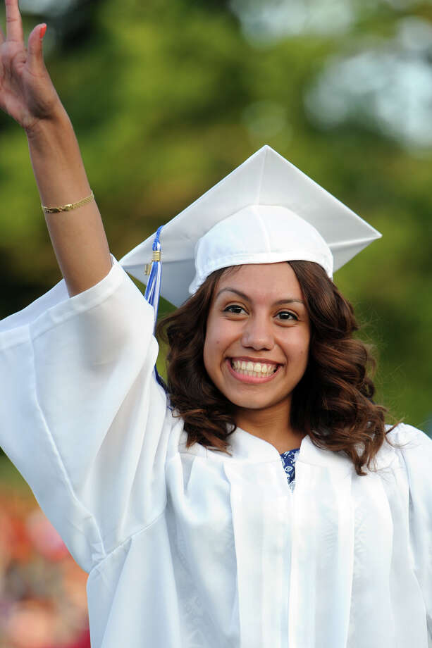 Graduate Brenda Montes waves after receiving her dipolama during commencement for the Frank Scott Bunnell High School Class of 2014, in Stratford, Conn. June 18, 2014. Photo: Ned Gerard / Connecticut Post