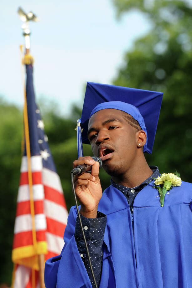 "Graduate Dashon Pratt sings ""God Bless America"" during commencement for the Frank Scott Bunnell High School Class of 2014, in Stratford, Conn. June 18, 2014. Photo: Ned Gerard / Connecticut Post"