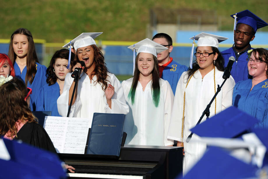 Graduate Enysia Martinez and other choir members sing during commencement for the Frank Scott Bunnell High School Class of 2014, in Stratford, Conn. June 18, 2014. Photo: Ned Gerard / Connecticut Post