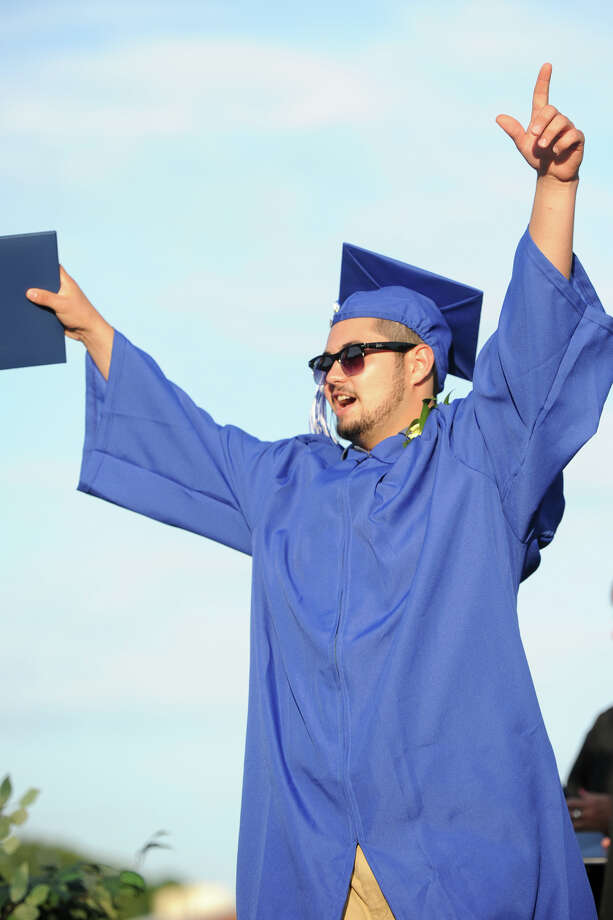 Graduate Miguel Barreira celebrates during commencement for the Frank Scott Bunnell High School Class of 2014, in Stratford, Conn. June 18, 2014. Photo: Ned Gerard / Connecticut Post