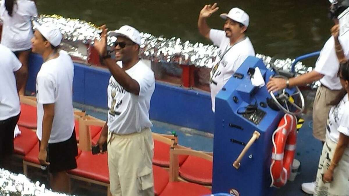 David Robinson waves to the crowd during the Spurs victory parade on the San Antonio River on Wednesday, June 18, 2014.
