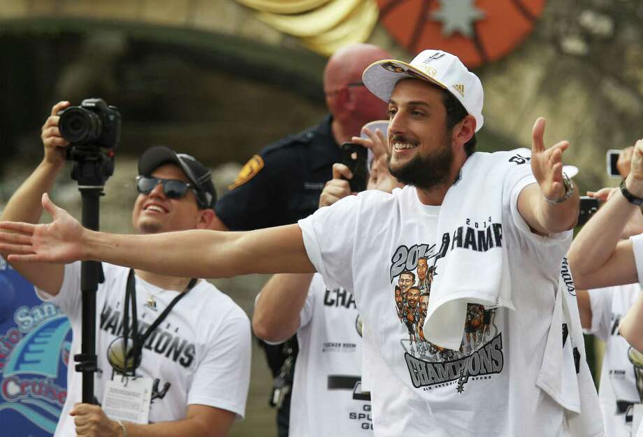 San Antonio Spurs' Marco Belinelli acknowledges a crowd at the Arneson Theater during the river parade for the San Antonio Spurs after the team capture their fifth NBA championship on Wednesday, June 18, 2014. Photo: Kin Man Hui, San Antonio Express-News / ©2014 San Antonio Express-News