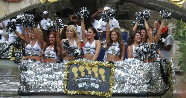 Spurs Silverdancers greet a crowd at the Arneson Theater during a river parade for the San Antonio Spurs after the team capture their fifth NBA championship on Wednesday, June 18, 2014. Photo: Kin Man Hui, San Antonio Express-News / ©2014 San Antonio Express-News
