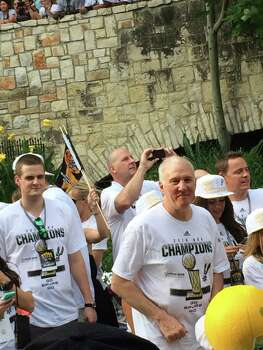Gregg Popovich smiles at the crowd along the River Walk during the Spurs river parade on Wednesday, June 18, 2014. Photo: Mitchell Ferman / San Antonio Express-News