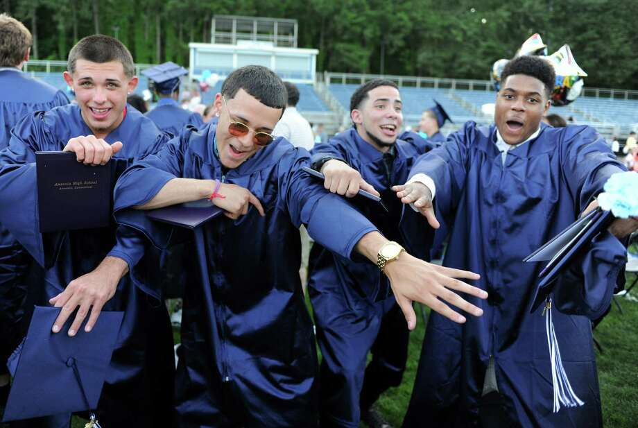 Scenes from the Ansonia High School commencement ceremony Wednesday, June 18, 2014 at Nolan Field in Ansonia, Conn. Photo: Autumn Driscoll / Connecticut Post