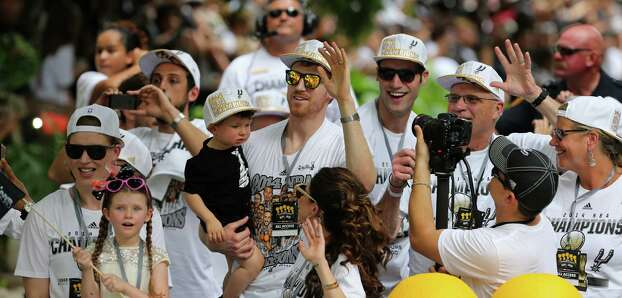 San Antonio Spurs' Matt Bonner (center) and others take part in the river parade, Wednesday June 18, 2014, for the Spurs after the team captured their fifth NBA championship. Photo: Edward A. Ornelas, San Antonio Express-News / © 2014 San Antonio Express-News