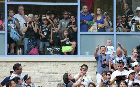 San Antonio Spurs fans wait for the team to pass Wednesday June 18, 2014 during the river parade for the Spurs after the team captured their fifth NBA championship. Photo: Edward A. Ornelas, San Antonio Express-News / © 2014 San Antonio Express-News