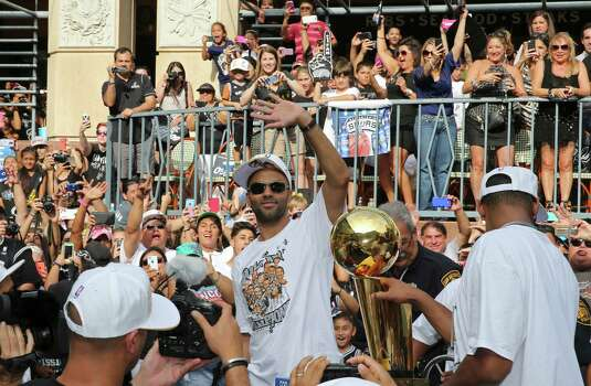 San Antonio Spurs' Tony Parker (left) and Boris Diaw  take part in the river parade, Wednesday June 18, 2014, for the  Spurs after the team captured their fifth NBA championship. Photo: Edward A. Ornelas, San Antonio Express-News / © 2014 San Antonio Express-News