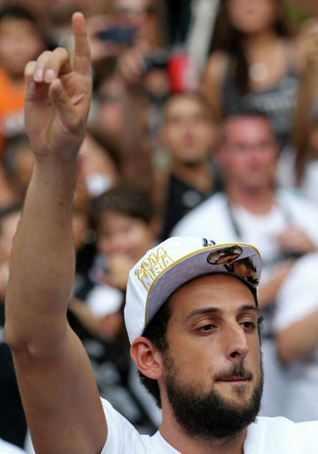 San Antonio Spurs' Marco Belinelli gestures Wednesday June 18, 2014 during the river parade for the San Antonio Spurs after the team captured their fifth NBA championship. Photo: Edward A. Ornelas, San Antonio Express-News / © 2014 San Antonio Express-News