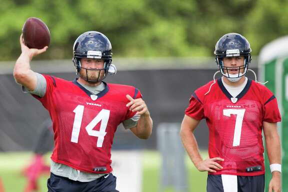 Houston Texans quarterback Ryan Fitzpatrick (14) throws a pass as Case Keenum looks on during Texans' minicamp at the Methodist Training Center Wednesday, June 18, 2014, in Houston.  ( Brett Coomer / Houston Chronicle )