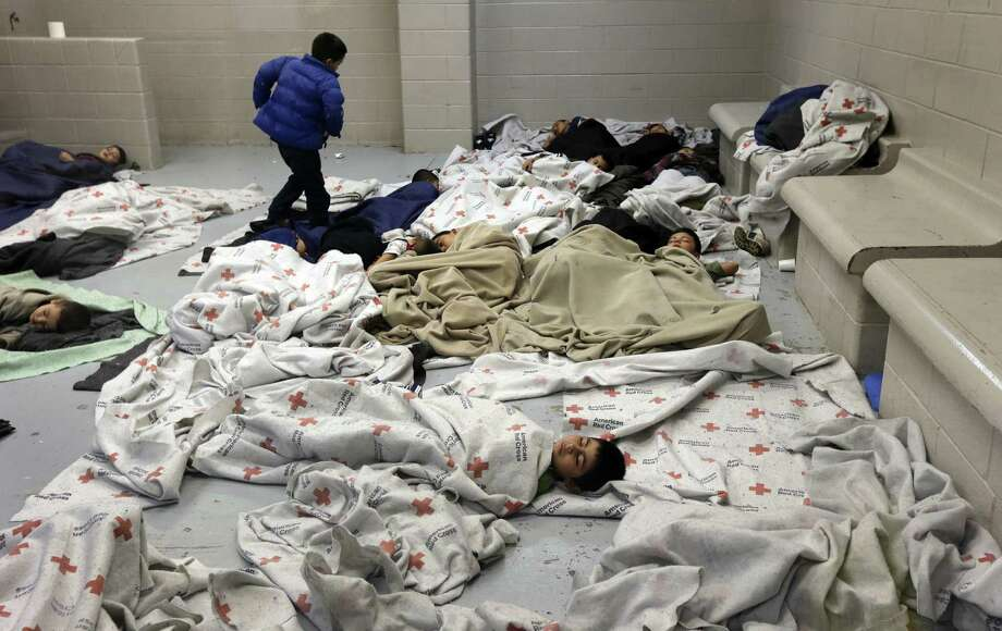 Detainees sleep in a holding cell at a U.S. Customs and Border Protection processing facility  in Brownsville. Photo: Eric Gay / Associated Press / POOL AP