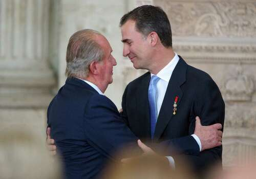 Abdicating King Juan Carlos (left) greets Prince Felipe before the official ceremony at the Royal Palace in the Spanish capital of Madrid. Photo: Carlos Alvarez / Getty Images / 2014 Getty Images