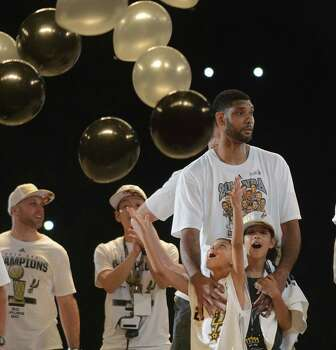 Tim Duncan's children, Sydney and Draven, watch for balloons during a clebration of the Spurs fifth NBA championship on Wednesday, June 18, 2014, in the Alamodome. Photo: Billy Calzada, San Antonio Express-News / San Antonio Express-News