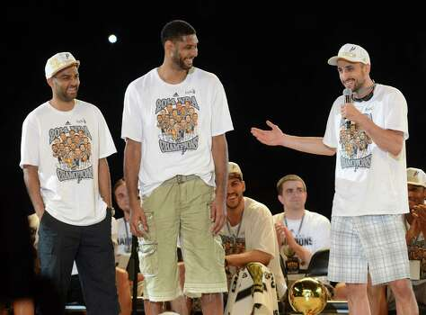 "The San Antonio Spurs ""Big 3,"" Tony Parker, left, Tim Duncan and Manu Ginobili talk onstage during a celebration of the Spurs fifth NBA championship on Wednesday, June 18, 2014, in the Alamodome. Photo: Billy Calzada, San Antonio Express-News / San Antonio Express-News"
