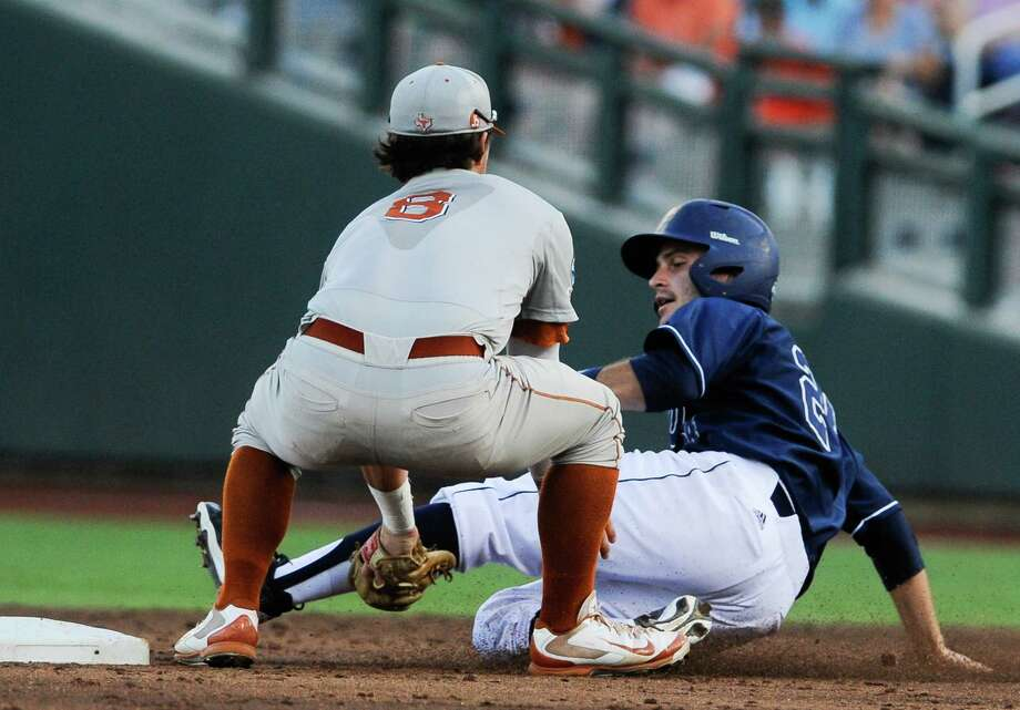 UC Irvine's Kris Paulino, right, is caught stealing by Texas second baseman Brooks Marlow (8) in the second inning of an NCAA baseball College World Series elimination game in Omaha, Neb., Wednesday, June 18, 2014. (AP Photo/Eric Francis) Photo: Eric Francis, Associated Press / FR9944 AP