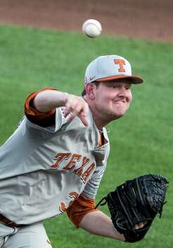 Texas starting pitcher Chad Hollingsworth delivers against UC Irvine in the first inning of an NCAA baseball College World Series elimination game in Omaha, Neb., Wednesday, June 18, 2014. (AP Photo/Nati Harnik) Photo: Nati Harnik, Associated Press / AP