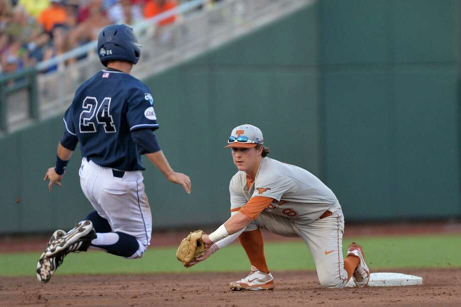 UC Irvine's Kris Paulino (24) is caught stealing by Texas second baseman Brooks Marlow, right, in the second inning of an NCAA baseball College World Series elimination game in Omaha, Neb., Wednesday, June 18, 2014 (AP Photo/Ted Kirk) Photo: Ted Kirk, Associated Press / FR34398 AP