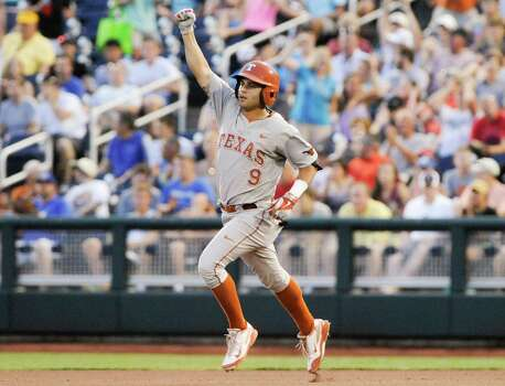 Texas' C.J Hinojosa (9) raises his fist as he rounds the bases after hitting a solo home run against UC Irvine in the seventh inning of an NCAA baseball College World Series elimination game in Omaha, Neb., Wednesday, June 18, 2014. (AP Photo/Eric Francis) Photo: Eric Francis, Associated Press / FR9944 AP