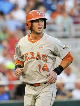 Texas' Ben Johnson who thought he had hit a triple reacts after being called out for not stepping on first base, in the sixth inning of an NCAA baseball College World Series elimination game against UC Irvine in Omaha, Neb., Wednesday, June 18, 2014. (AP Photo/Ted Kirk) Photo: Ted Kirk, Associated Press / FR34398 AP